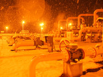 Oil/gas pipeline in sonwing. A heavy snow night, I in the work place, of natural gas pipeline stock photography