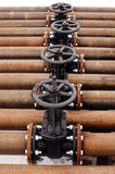 Oil and gas pipeline valves on a piping Royalty Free Stock Image
