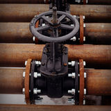Oil and gas pipeline valves on a piping Stock Photography