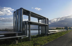 Oil and gas pipelines. Arch pipe is used to transport oil and gas stock photos