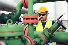 Oil and gas and pipelines with engineer talking in phone stock images