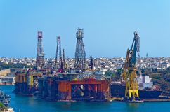 Oil and gas platform in a bay of Valletta, Malta. The Oil and gas platform in a bay of Valletta, Malta. View from Upper Barrakka Gardens stock photography