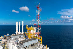 Oil and gas platform with gas burning, Power energy. Oil and gas platform in the gulf or the sea, The world energy, Offshore oil and rig construction Royalty Free Stock Image