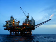 Oil and gas platform. During twilight time Royalty Free Stock Photo