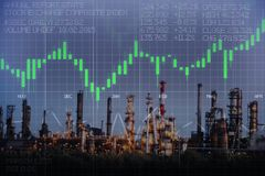 Oil and gas price evolution with refinery power station and stock market business graph. Oil and gas price evolution with refinery power station in the night and Stock Photo