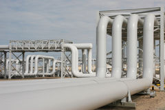 Oil and Gas Process Plant Supplying Energy. Pipes and structures in an oil and gas facility stock image