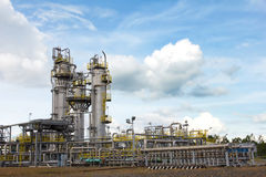 Oil and gas processing facility. Landscape of oil and gas processing facility with blue sky royalty free stock photo