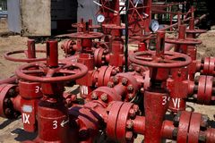 Oil and gas processing plant with pipe line valves. Oil pipeline valves in the oil and gas industry. Valve plug an oil pipeline in. The field on a sunny summer stock photos
