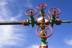 Oil and gas processing plant with pipe line valves. Oil pipeline valves in the oil and gas industry. Valve plug an oil pipeline in. The field on a sunny summer royalty free stock photos