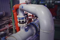 Oil and gas processing plant with pipe line valves. Oil pipeline valves in the oil and gas industry. Valve plug an oil pipeline in. The field on a sunny summer stock images