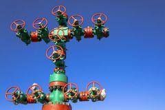 Oil and gas processing plant with pipe line valves. Oil pipeline valves in the oil and gas industry. Valve plug an oil pipeline in. The field on a sunny summer stock photo