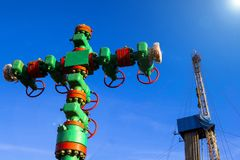 Oil and gas processing plant with pipe line valves. Oil pipeline valves in the oil and gas industry. Valve plug an oil pipeline in. The field on a sunny summer stock photography