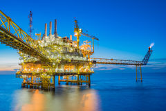 Oil and gas processing platform producing oil gas and water sent. To onshore refinery and power generation plant stock image