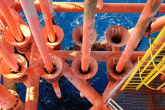 Oil and Gas Producing Slots at Offshore Platform. Oil and Gas Industry. Well head slot on the platform or rig. Production and Explorer industry Stock Image