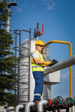 Oil and Gas Production Operator. With yelow helmet stock image
