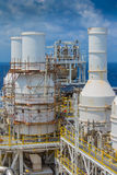 Oil and gas production platform and exhaust of gas compressor at the top of deck. Stock Photography