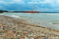 Oil and gas production at sea, red oil station royalty free stock photography