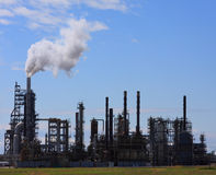 Oil and Gas Refinery. View of an oil refinery from across a field royalty free stock images