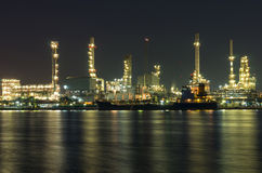 Oil and gas refinery at night time - Petrochemical factory Stock Photos