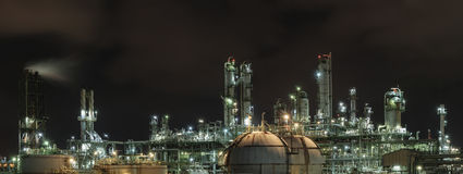Landscape of industrial. Oil and gas refinery plant and lighting with night view Stock Images