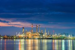 Oil and Gas refinery plant and loading dock at twilight royalty free stock photos