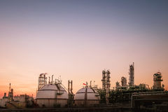 Oil and gas refinery plant. Oil and gas storage spheres tank in oil refinery industrial on sky sunset background Stock Images