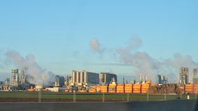 Oil and gas refinery with smoking chimney Royalty Free Stock Photography