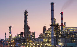 Oil and gas refinery at twilight Stock Image
