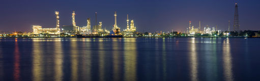 Oil and gas refinery at twilight panorama - Petrochemical factor Royalty Free Stock Image