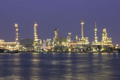 Oil and gas refinery at twilight - Petrochemical factory Royalty Free Stock Photography