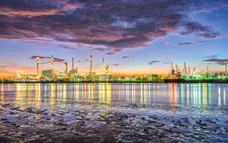 Oil and gas refinery at twilight - Petrochemical factory royalty free stock photos