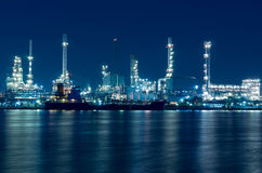Oil and gas refinery at twilight - Petrochemical factory Royalty Free Stock Photo