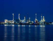 Oil and gas refinery at twilight time - Petrochemical factory Stock Photos