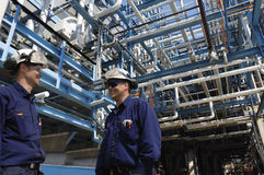 Oil and gas refinery with workers Stock Photo