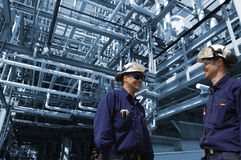 Oil and gas refinery with workers Stock Photos