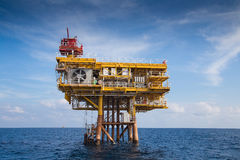 Oil and Gas remote wellhead platform for oil and gas business,looking from crew boat. Royalty Free Stock Images