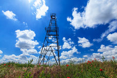 Oil and gas rig structure. Profiled on blue sky royalty free stock image