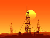 Oil and gas rigs over orange desert sunset illustration Royalty Free Stock Images