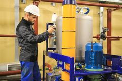 Oil and gas service engineer on industrial factory. Maintenance of gas installation. Technician on job royalty free stock image
