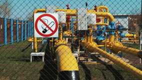 Oil gas station. Transportation of fuel through a pipeline. no smoking. Stop valves on pipes with manometers stock video