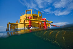 Oil and gas transfer platforms. With workers royalty free stock photos