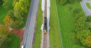 Oil and gas, transport by train. Beautiful summer nature and cargo train, runs through the city. Aerial footage stock video footage