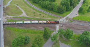 Oil and gas, transport by train. Beautiful summer nature and cargo train, runs through the city. Aerial footage stock video