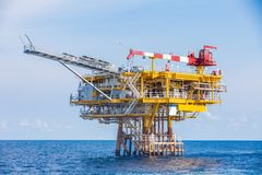 Oil and gas wellhead remote platform produced raw gases and crude then sent to central processing platform. Stock Image