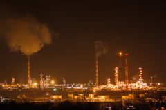 Oil and gas work industry factory at night Stock Images