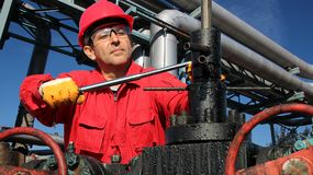 Oil and Gas Worker in Action Inside Refinery stock photography