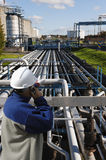 Oil and gas worker in front of refinery Stock Photos