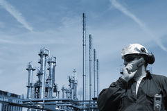 Oil and gas worker with refinery. Oil and gas workers inside large petrochemical refinery industry Stock Photos