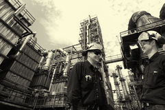 Oil and gas workers inside chemical refinery Stock Photography