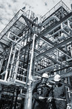 Oil and gas workers inside industry Royalty Free Stock Photo
